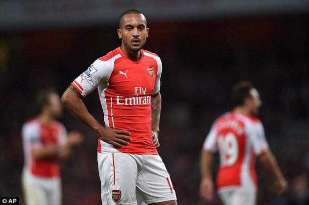 1415053720589_wps_1_Arsenal_s_Theo_Walcott_lo