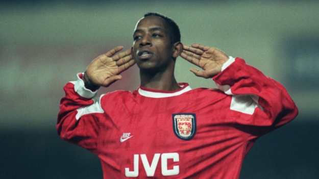 10 JAN 1996:  Ian Wright of Arsenal listens to the cheers of the supporters after he scored in the Coca Cola Cup quarter final match against Newcastle at Highbury.