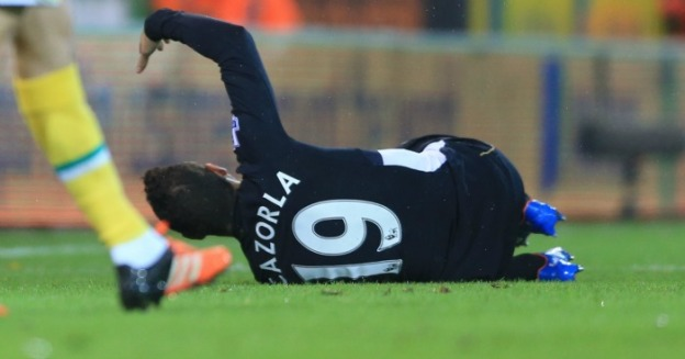 Arsenal's Santi Cazorla goes down injured against Norwich City.